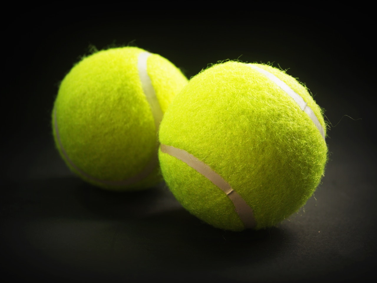 Tennis Balls on black background